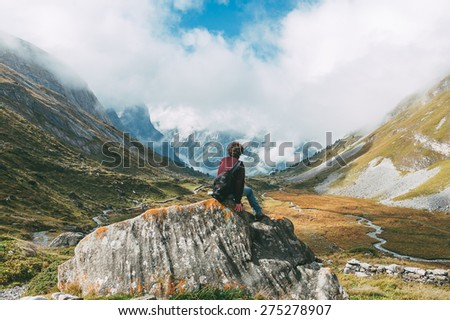 A man in front of a mountainous landscape