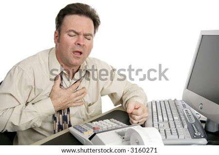 A man in his forties experiencing chest pain while working in his office.  Isolated on white. - stock photo