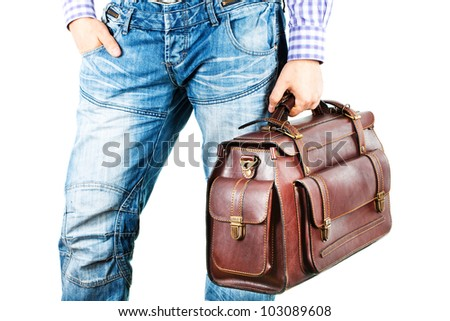A man in jeans with a brown leather travel bag (isolated on white background) - stock photo