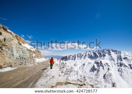 A man in Khardung la pass. Khardung la is the world's highest motorable pass.