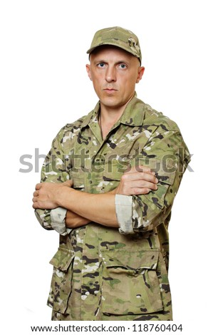 A man in military uniform, camouflage. White background. Isolated. - stock photo
