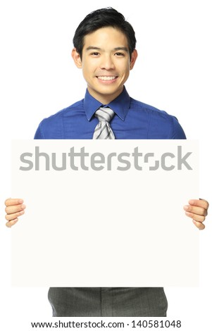 A man in office attire holding a blank message  - stock photo