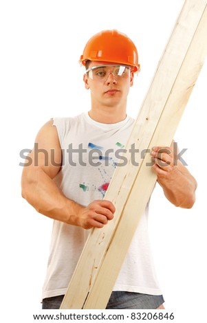 A man in orange hard hat wiyh a wood plank, isolated on white background. - stock photo