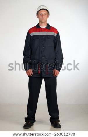 A man in overalls and work wear.Isolated studio portarit - stock photo