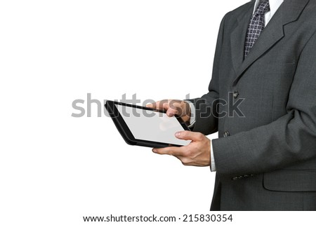 A man in suit is holding a tablet with a white screen.
