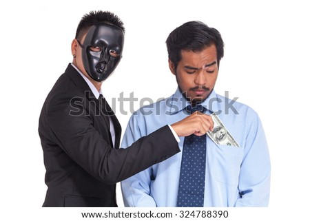 A man in suit put bank note in the pocket. Corruption. - stock photo