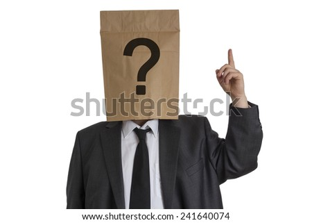A Man in suit with a paper bag with a question mark on his head pointing upward isolated on white background - stock photo