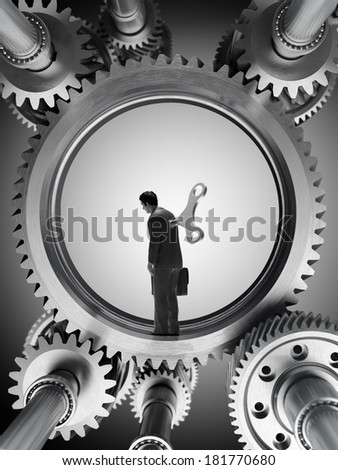 A man inside a machine with a wind-up key - stock photo