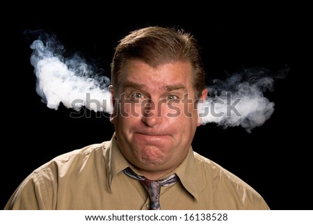 A man is angry and venting smoke from his ears in a classic expression shared in illustrations and cartoons. - stock photo