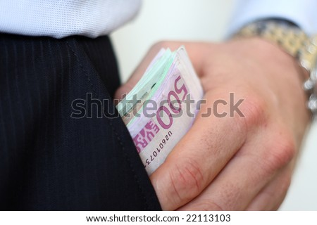 A man is getting a bundle of Euro notes out of his pocket