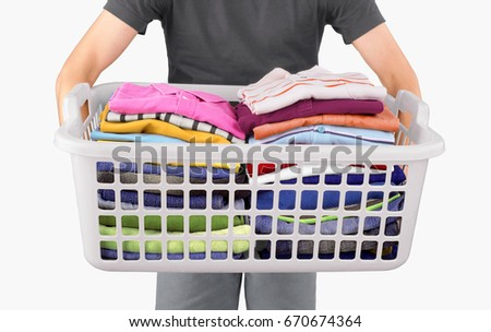 A man is holding a laundry basket