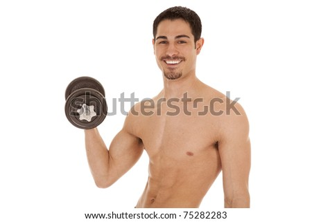 A man is holding up some weights with a big smile.