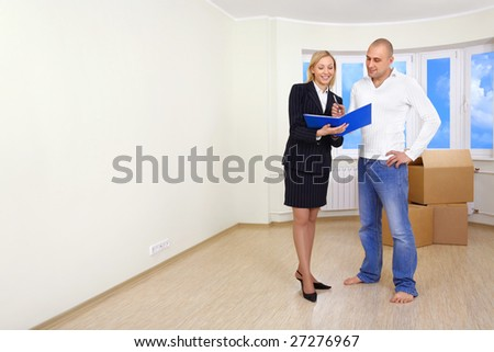 A man is signing a contract for buying a house - stock photo