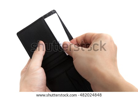 A man is taking a card from wallet on white background.