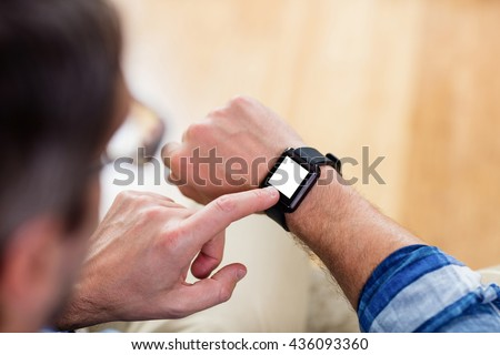 A man is touching his watch - stock photo