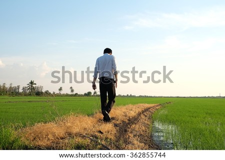 a man is walking along the ridge