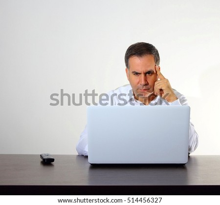 A man is working with computer