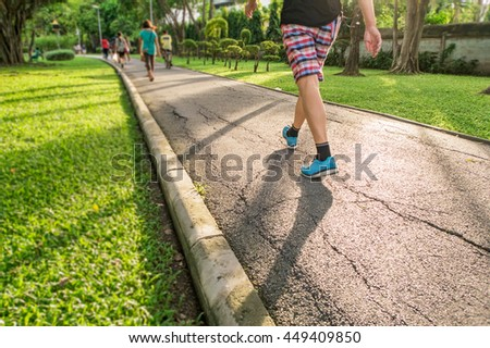 A man jogging in the park ,in the evening light,(from below angle view) - stock photo