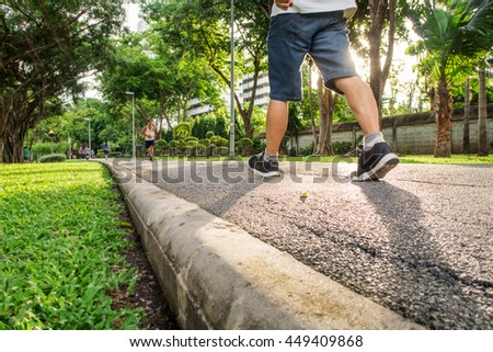 A man jogging in the park ,in the evening light, (from below angle view) - stock photo