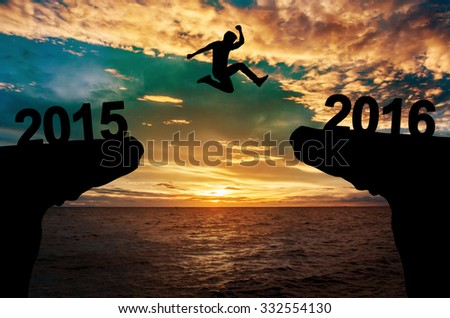 A man jump between 2015 and 2016 years. - stock photo