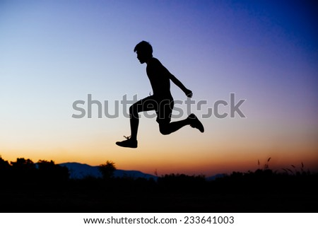 a man jumping in the sky