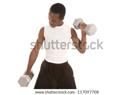 A man lifting weights with a serious expression. - stock photo