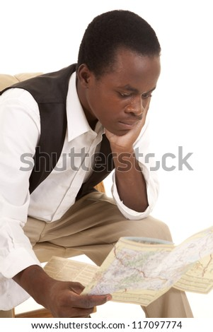 A man looking at a road map with a serious expression.