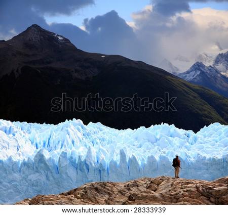 A man looking at Perito Moreno Glacier, Patagonia, Argentina - stock photo