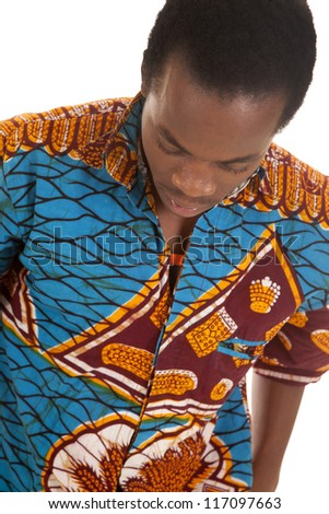 A man looking down in his colorful shirt with a serious expression on his face.