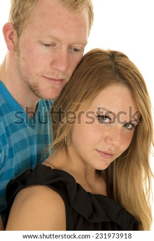 A man looking down while the woman is looking up. - stock photo