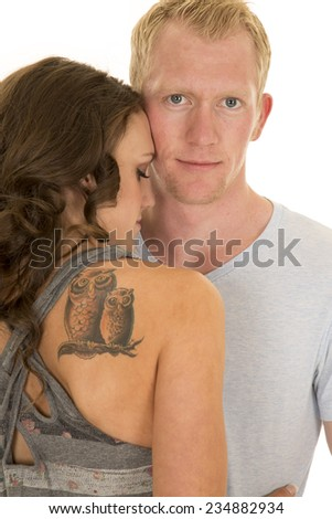A man looking with his woman cuddling close to him. - stock photo