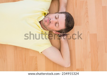 A man lying on floor at home in the living room