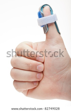 "A man makes the ""thumbs up"" gesture while wearing a thumb splint. Photographed in front of a white backdrop, but not ""cut out"" with software. - stock photo"