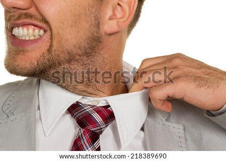 a man (manager) feels constricted. the collar bursts. - stock photo