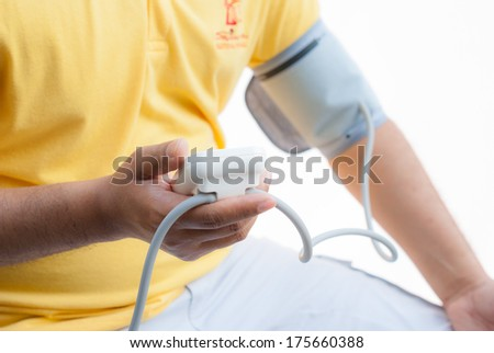 a man measures his blood pressure - stock photo