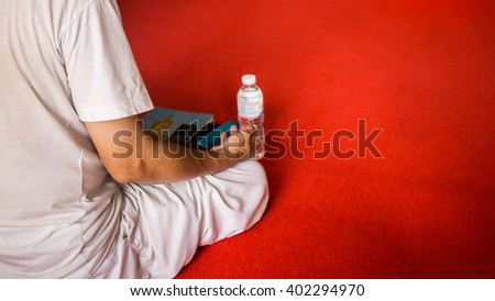 A man meditating alone in the temple - stock photo