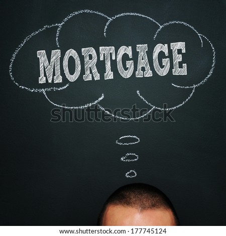 a man over a blackboard with a thought bubble drawn in it and the word mortgage, depicting the idea of being worried about the mortgage - stock photo