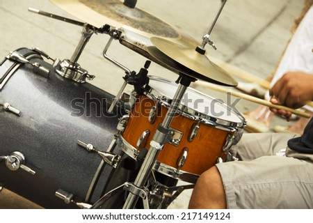 A man playing drums on the street in New York City - stock photo