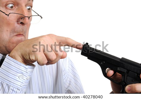 A man playing with a gun on white background