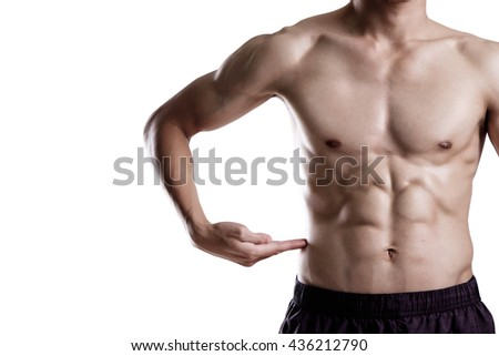 A man pointing hand on his six pack isolate on white background. - stock photo