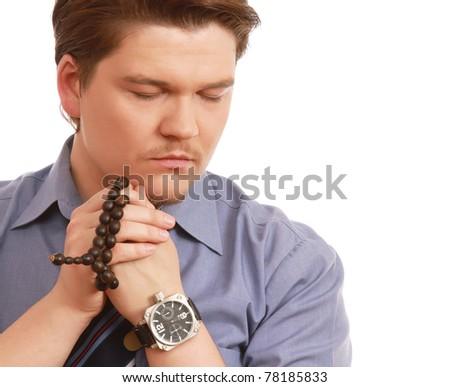 A man praying - stock photo