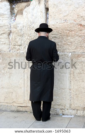 A Man Praying at the Western Wall - stock photo