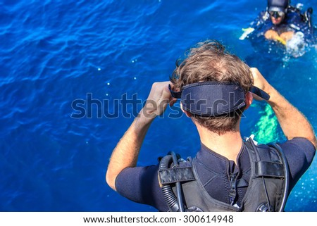 A man preparing himself for diving in to water - stock photo