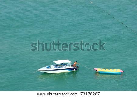 a man preparing his banana boat - stock photo