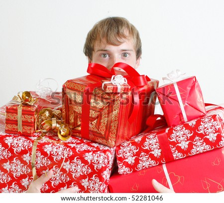 A man presenting several christmas presents - stock photo
