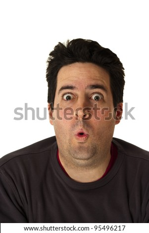 A man pulls a funny face isolated on white - stock photo