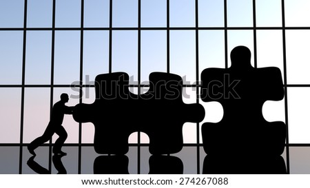 A man pushing a piece of puzzle to assemble two pieces. Concept illustration. - stock photo