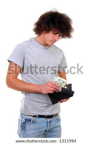 A man puts money in his wallet - stock photo