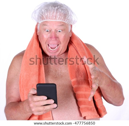A man reacts to a photo he sees on his cell phone as he exits the shower. isolated on white. room for text. Shutterstock model released
