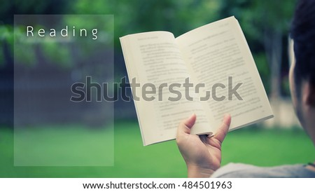 "A man reading a book in garden,relaxing in garden home with outdoor,copy space for a add text on picture and wording ""Reading"",Reading concept learn your self."